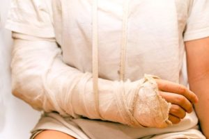 woman on white clothing with injured arm
