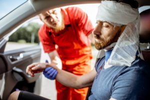 injured passenger being assisted - car accident aftermath