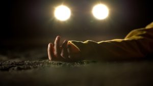 body of a pedestrian laying on the floor at night after hit-and-run accident