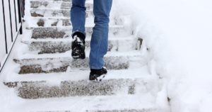 man taking the icy stairway
